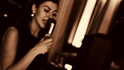 Young beautiful woman singing.