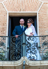 Bride and Groom on a Balcony