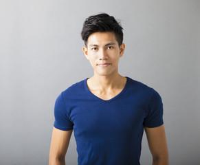 smiling muscular asian young man