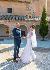 Bride and Groom in a Spanish Courtyard in the Sunshine