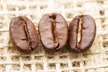 three roasted coffee beans