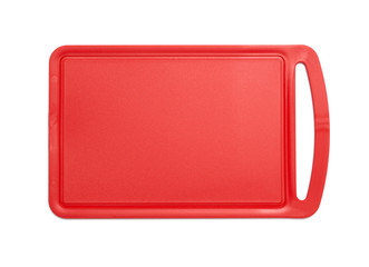 Red plastic cutting board isolated on white