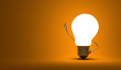 Light bulb character, aha moment, orange background - 73966428