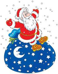 Santa Claus sitting on his big bag of Christmas gifts