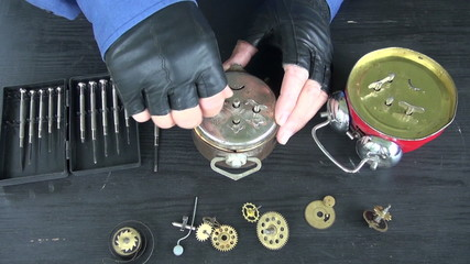watchmaker repair old analog clock