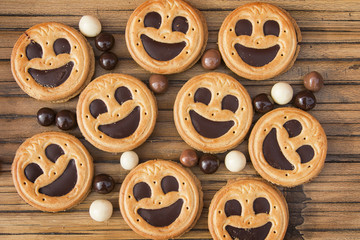 Round smiling chocolate cookies with chocolate balls