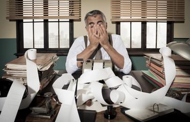 Retro desperate accountant head in hands