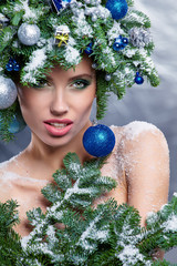 Beautiful woman portrait  in creative christmas  image.