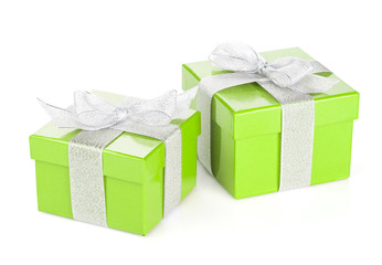 Two green gift boxes with silver ribbon and bow