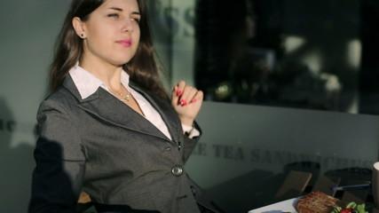 Businesswoman relaxing outside the restaurant, steadycam shot