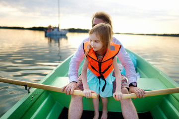 Little girl with her father on a boat