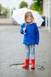 Adorable little girl holding white umbrella