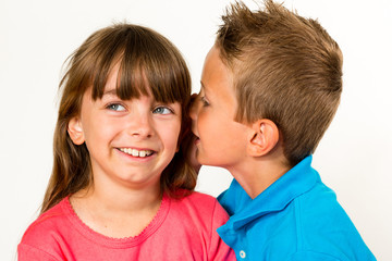 Boy whispering to girl