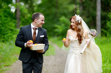 Young bride and groom taking a walk