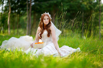 Young bride sitting on a grass