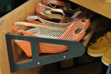 shoes on a wooden storage cabinet