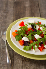salad of roasted beets and pumpkin with feta cheese and arugula