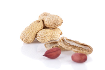 peanuts cracked open isolated on a white background