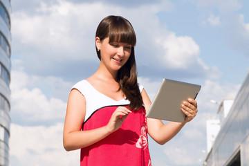 Beautiful woman using tablet