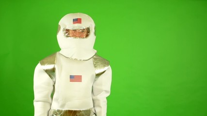 astronaut looks to the camera and smiles - green screen