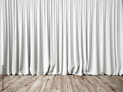 White curtains and wood floor