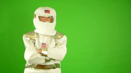 astronaut looks to the camera - green screen