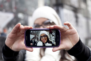 Woman takes picture of herself
