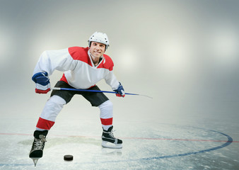 Smiling hockey player on ice