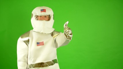 astronaut shows one thumb on agreement - green screen
