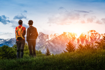 two girls look at the mountains while hiking