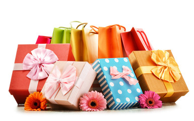 Colorful gift boxes and bags isolated on white