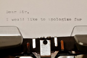 Text Dear Sir typed on old typewriter