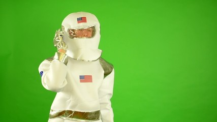 astronaut calls by phone - green screen