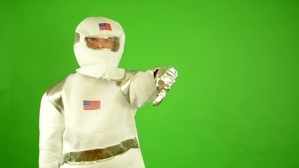 astronaut showing thumbs on disagreement - green screen