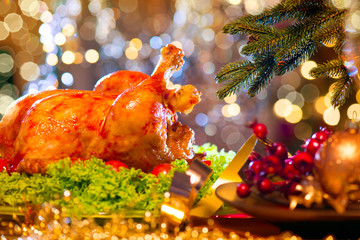 Christmas dinner. Holiday decorated table with roasted turkey