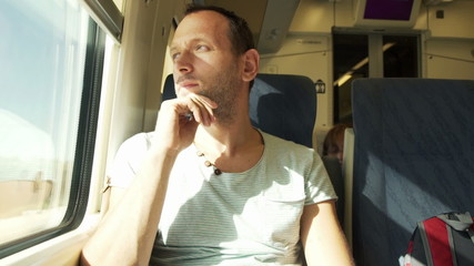 Serious, thoughtful man during train ride