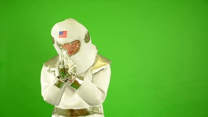 astronaut prays - green screen