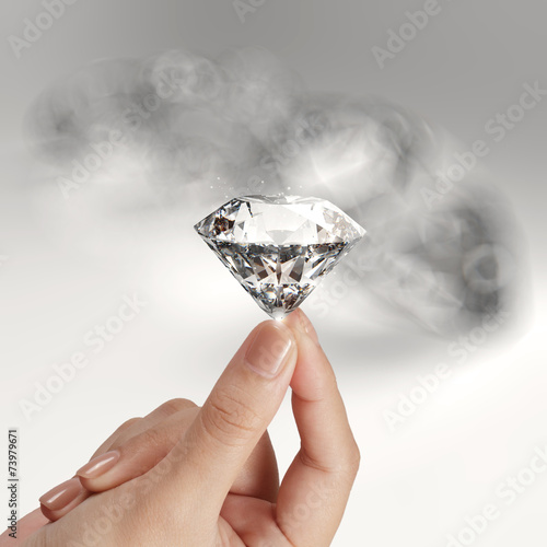 canvas print picture hand holding 3d diamond over grey background