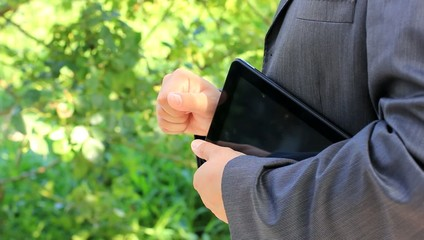 Businessman with tablet speaking
