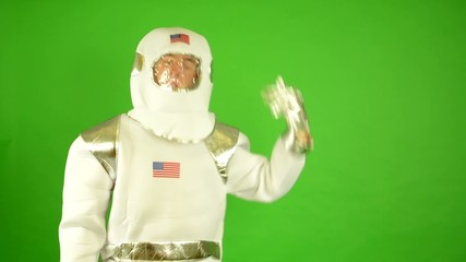 concept: astronaut shoot himself - green screen