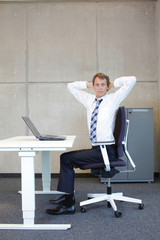 exercises in office. business man arm-neck stretching