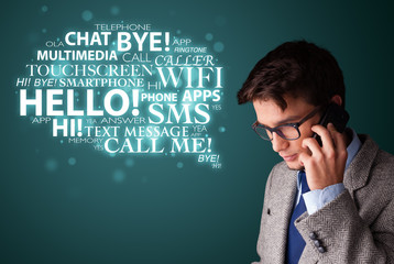 Young man making phone call with word cloud