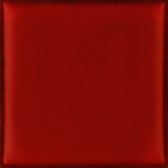 Red background from soft and smooth leather with stitched frame