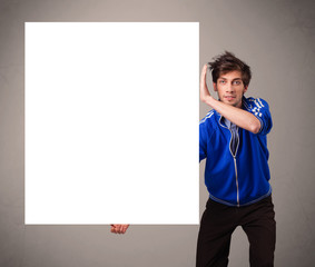 Young boy presenting white paper copy space