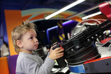 Boy playing a first person shooter