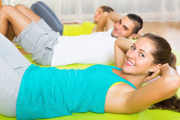 Smiling people working in gym