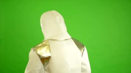 astronaut walks in universe - green screen