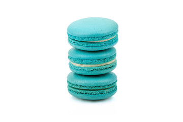 Three green colored macaroons isolated
