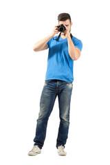 Standing photographer taking photo