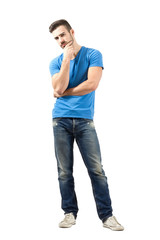 Skeptical young man looking at camera